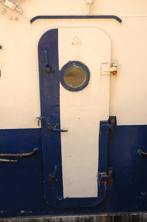 wicket door: Old metal door on fishing vessel Stock Photo