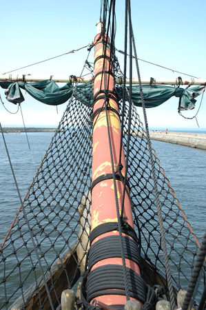 bowsprit: Bowsprit on old sailing vessel bow in harbour