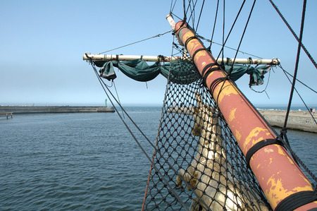 bowsprit: Bowsprit on old sailing vessel bow swiming in harbour Stock Photo