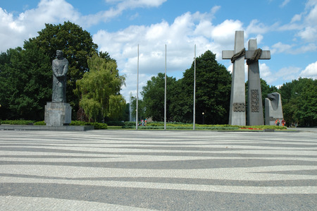 mickiewicz: Poznan, Poland - July 13, 2014: Two monuments: Adam Mickiewicz and June 1956 Victims in Poznan, Poland. Unidentified people standing beetween them.