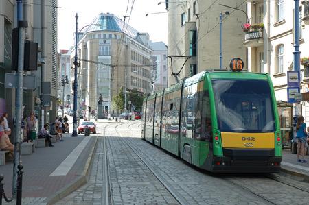 Poznan, Poland - July 13, 2014: Tram tracks, tram and unidentified people on Podgorna street in Poznan, Poland