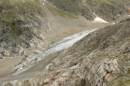 crevasse: Rocks and glacier (Steigletscher) in valley nearby Sustenpass in Alps in Switzerland. Stock Photo