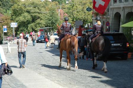 policewomen: Bern, Switzerland - August 15, 2014: Unidentified policewomen and other people on street in Bern, Switzerland.