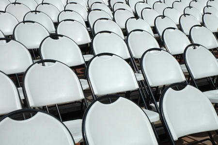 open air: Empty white plastic chairs in open air cinema
