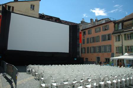 vevey: Vevey, Switzerland - August 16, 2014: Open air cinema in Vevey in Switzerland. Unidentified people visible.
