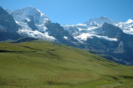 monch: Jungfraujoch pass nearby Kleine Scheidegg in Alps in Switzerland Stock Photo