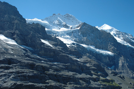 jungfraujoch: Peaks in snow nearby Jungfraujoch pass in Alps in Switzerland Stock Photo
