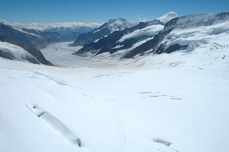 jungfraujoch: View from Jungfraujoch pass on glacier Jungfraufirn and Aletschgletscher in Alps in Switzerland Stock Photo