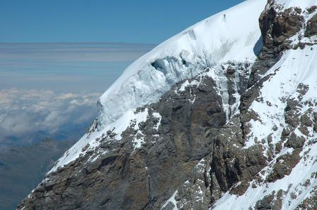 jungfraujoch: Ice and snow on rock nearby Jungfraujoch pass in Alps in Switzerland Stock Photo