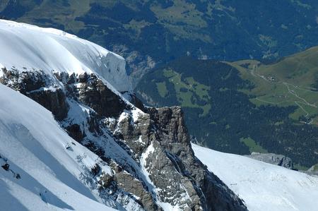 crevasse: Rock and snow nearby Jungfraujoch pass in Alps in Switzerland Stock Photo