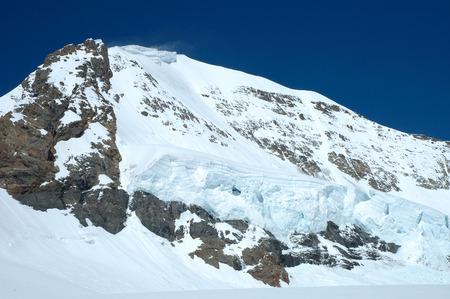 jungfraujoch: Snow and ice on Monch mountainside nearby Jungfraujoch in Alps in Switzerland Stock Photo