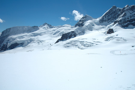 jungfraujoch: Snow and peaks nearby Jungfraujoch pass in Alps in Switzerland Stock Photo