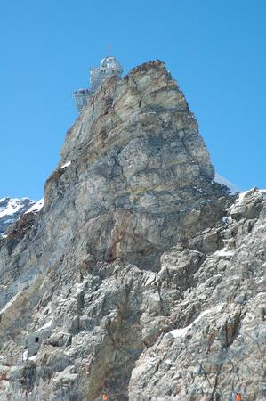 jungfraujoch: Jungfraujoch, Switzerland - August 18, 2014: Sphinx Observatory on top of rock on Jungfraujoch in Alps in Switzerland. Unidentified people visible. Editorial