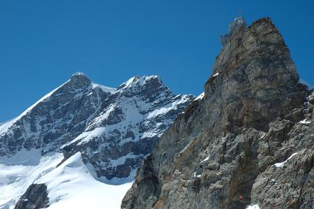 jungfraujoch: Jungfrau peak and Sphinx Observatory on rock on Jungfraujoch pass in Alps in Switzerland