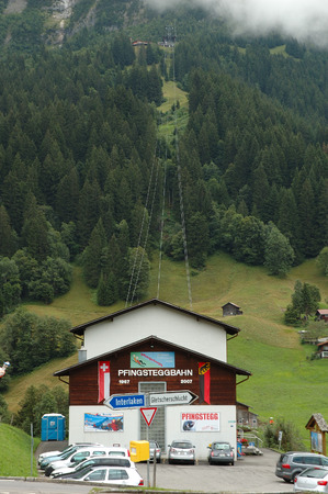 Grindelwald, Switzerland - August 19, 2014: Cars on parking at Pfinstegg cable car in Grindelwald in Alps in Switzerland