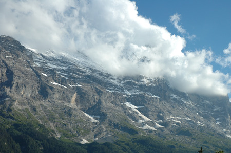 eiger: Ridge and  Eiger peak covered with clouds nearby Grindelwald in Alps in Switzerland