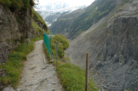 Trail from Grindelwald to Baregg in Alps in Switzerland photo