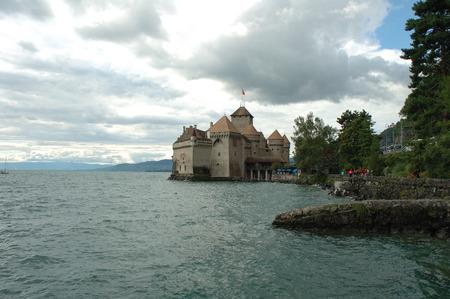 chillon: Montreux, Switzerland - August 16, 2014: Chateau de Chillon nearby Montreux in Switzerland at Geneve lake. Unidentified people visible