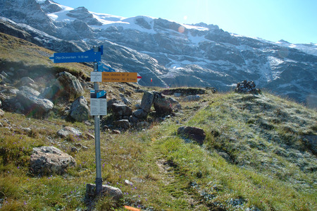Grindelwald, Switzerland - August 21, 2014: Trail signs at Glecksteinhutte mountain hostel nearby Grindelwald Alps in Switzerland.