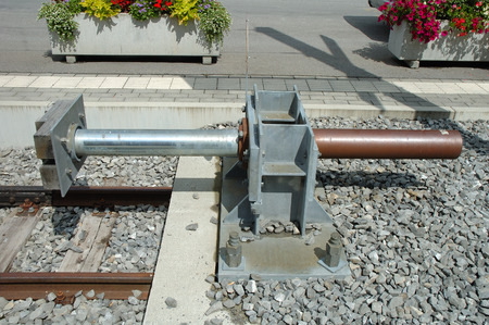 buffer: Modern buffer stop at the end of railway tracks on railway station.