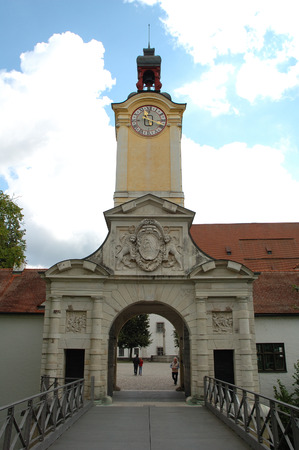 armament: Ingolstadt, Germany - August 24, 2014: Armament Museum gate with tower and clock in Ingolstadt in Germany. Unidentified people visible.