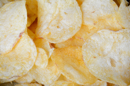 potato crisps: Golden potato crisps closeup - background