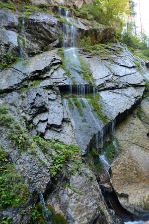 cataract waterfall: Moss on wet rock and flowing water