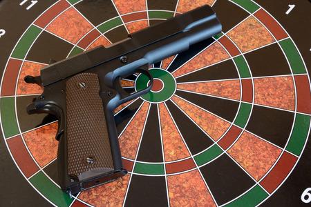 airsoft gun: Airsoft gun on target - dartboard