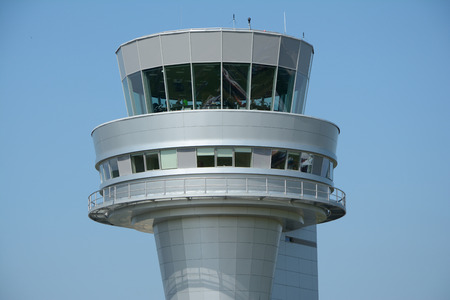 control tower: Poznan, Poland - June 18, 2015: Control tower on Poznan Lawica airport. Unidentified people visible.
