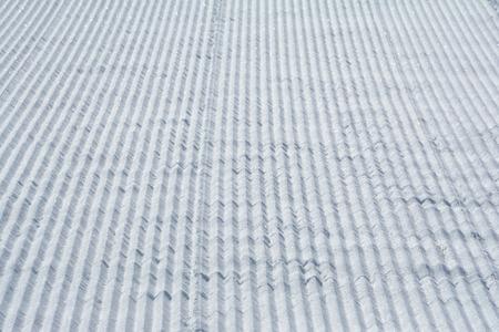 snowcat: Snowcat trace on snow background