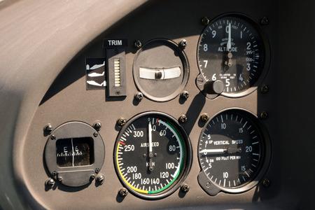 altimeter: Flight instruments in small sport airplane cockpit