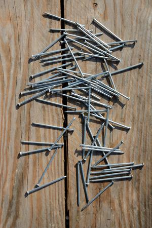 batch: Batch of nails on wooden planks