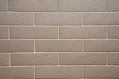 clinker tile: Brown clinker tiles on house wall - background. Stock Photo