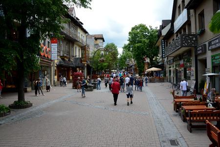 zakopane: Zakopane, Poland - June 15, 2016: Krupowki street in Zakopane in Poland. Unidentified people visible. Editorial
