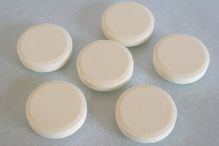soluble: Soluble tablets on glass table top closeup Stock Photo