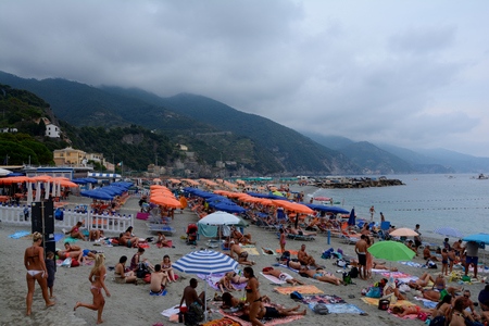 monterosso: Monterosso, Italy - September 4, 2016: Unidentified people on beach in Monterosso in Liguria, Italy. One of five Cinque Terre cities
