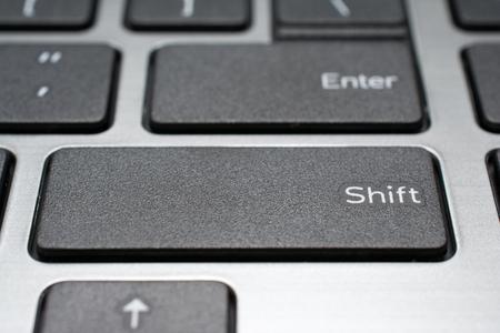 teclado numerico: Modern laptop keyboard closeup. Shift key. Shallow depth of field. Foto de archivo