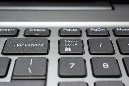 teclado numerico: Modern laptop keyboard closeup. Backspace and num lock keys. Shallow depth of field.