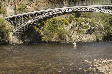 Thomas Telfords Craigellachie Bridge over the River Spey at Craigellachie. Stock Photo