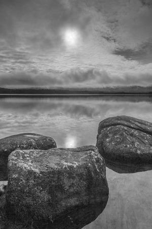 strathspey: Rocks on Loch Garten in the Cairngorms National Park of Scotland.