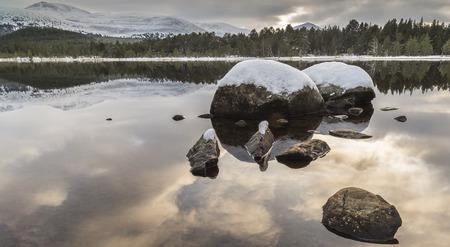 strathspey: Loch Morlich and the Cairngorms in Scotland.