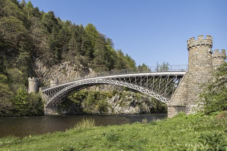 Thomas Telford Craigellachie Bridge over the River Spey in Scotland.