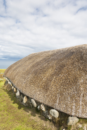 Thatched Blackhouse on Isle of Skye in Scotland. Stock Photo