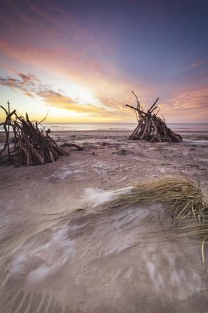 Driftwood hides on St Cyrus Coast in Scotland.