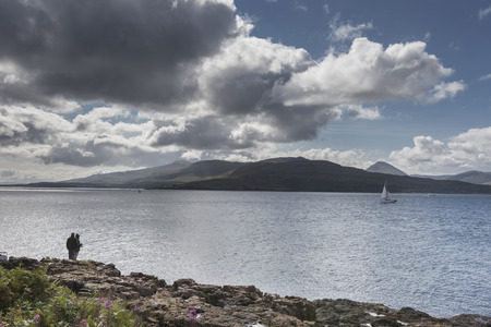 Fisherman at Clach Na Criche on the Sound of Mull in Scotland. Stock Photo