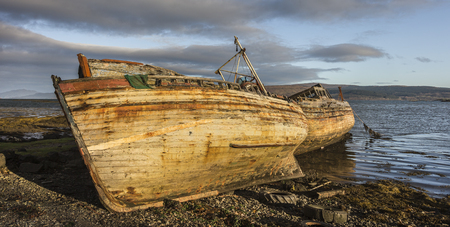 Fishing boat wrecks at Salen on the Isle of Mull in Scotland.