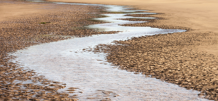 Winding Tidal water at St Cyrus in Aberdeenshire , Scotland.