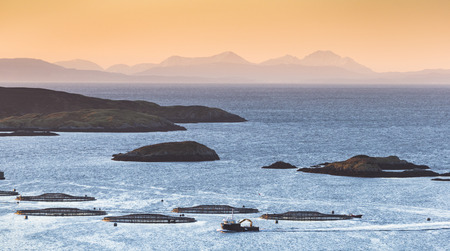 View of Fish farm and Isle of Skye looking out from Isle of Harris in the Outer Hebrides.
