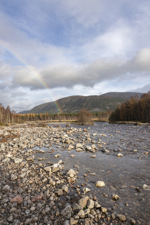 Rainbow over River Feshie in the Cairngorms National Park of Scotland.