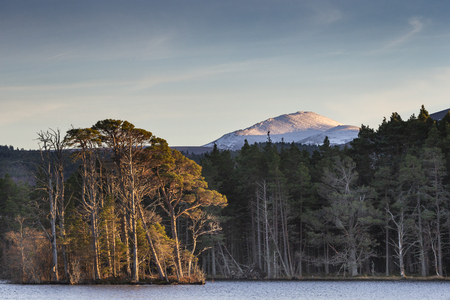 Bynack More Mountain and Loch Mallachie in the Cairngorms National Park of Scotland.